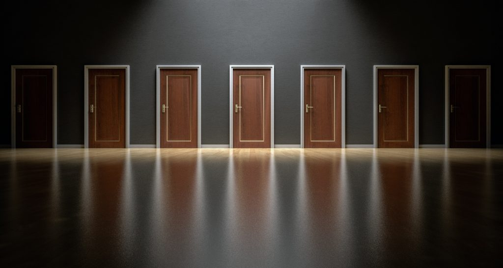 seven doors against a black background