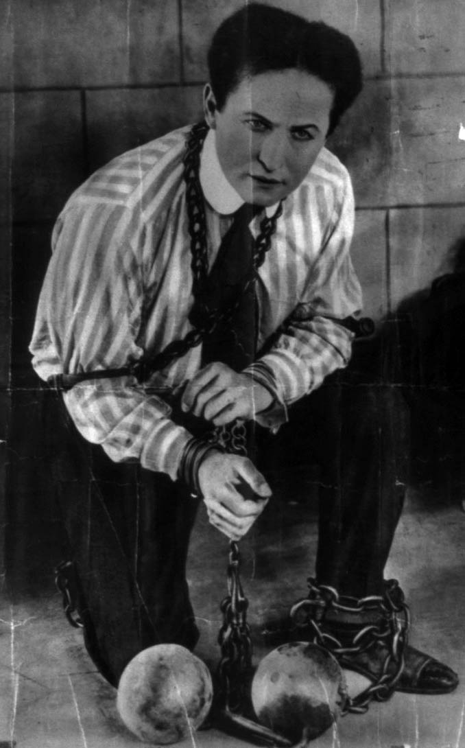 one of houdini's great act of escape with chains and handcuffs all over his body