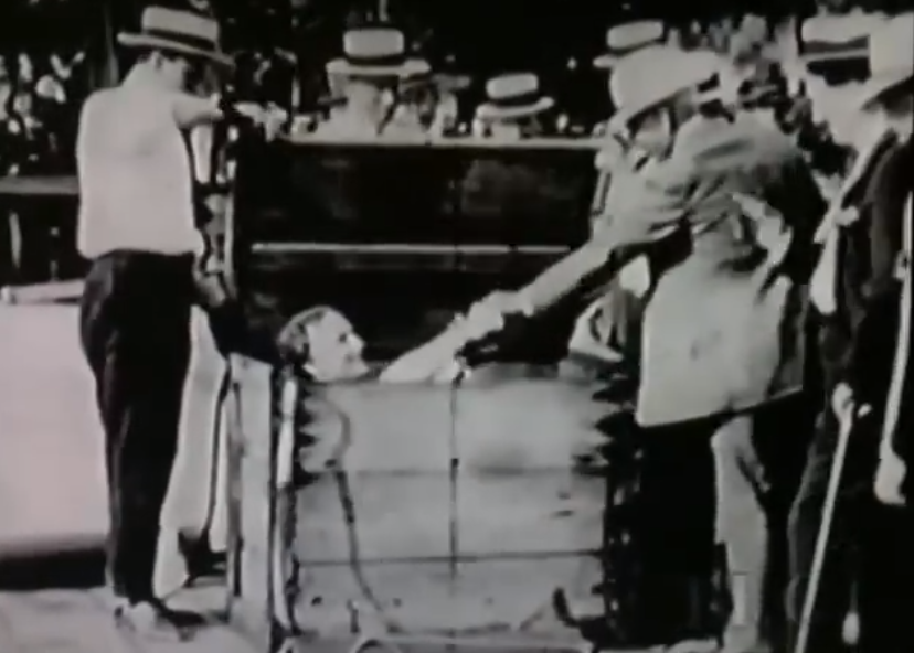 houdini performing an overboard box escape in public
