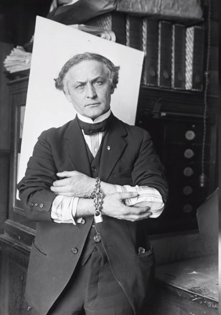 houdini with chains tying his hands together