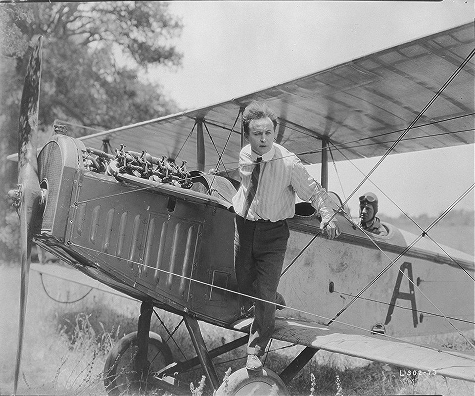 houdini riding on a private plane