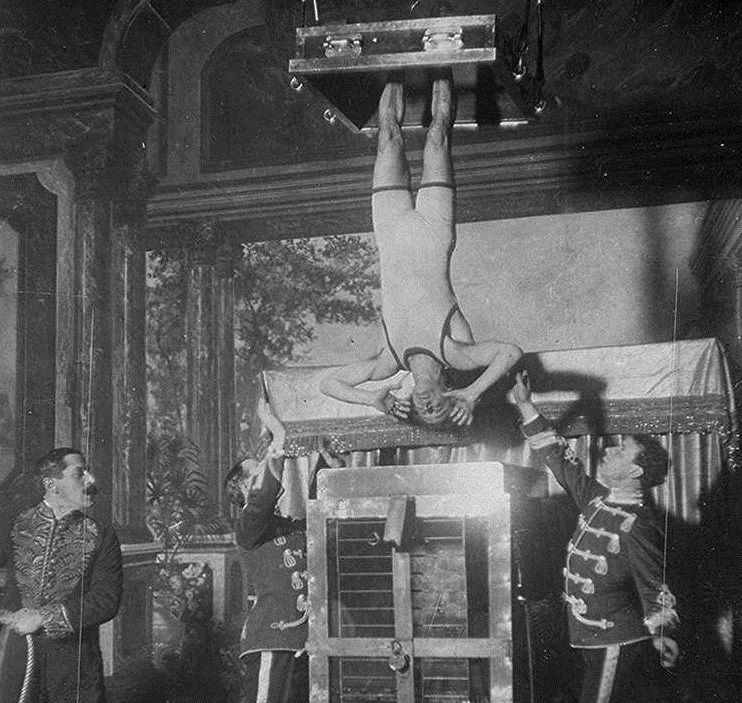 Harry Houdini performing the Chinese Water Torture escape