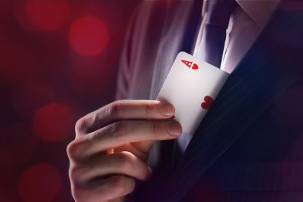 Magician with ace card hidden under the jacket