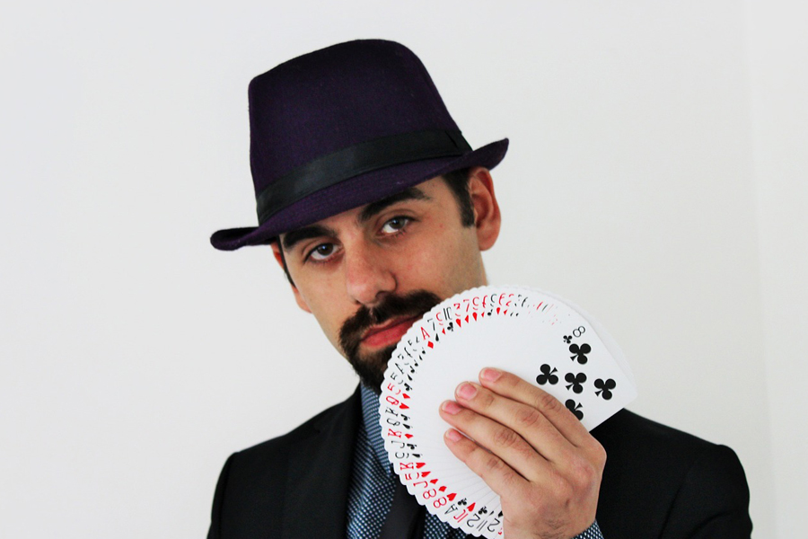 Majician Holding a deck of cards card