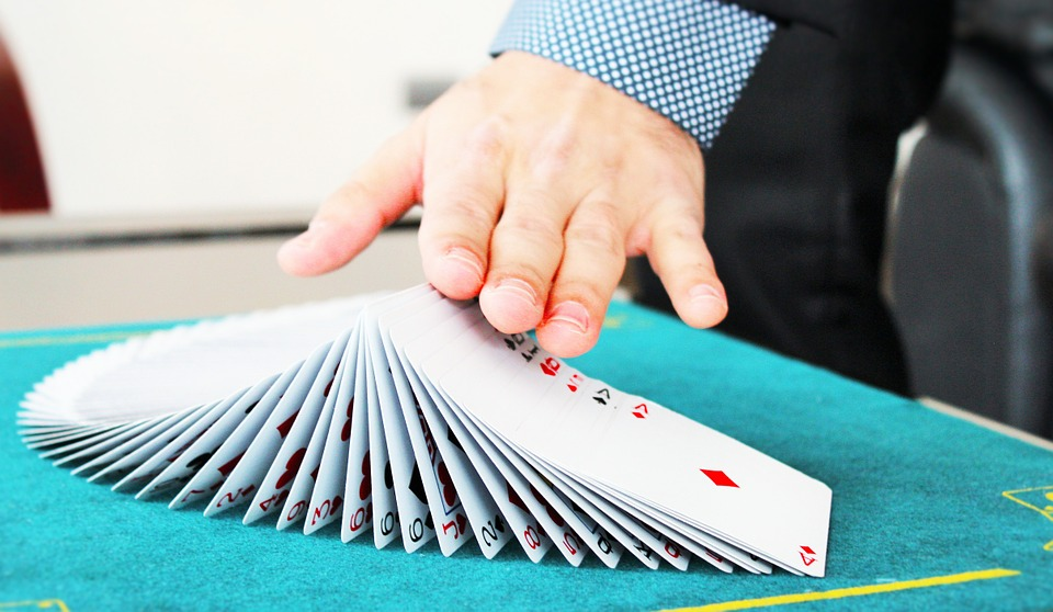 magician doing tricks with cards