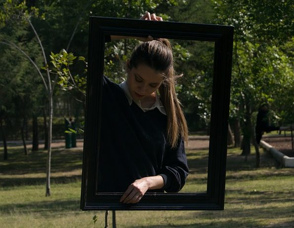 Illusion of a girl inside a frame levitating