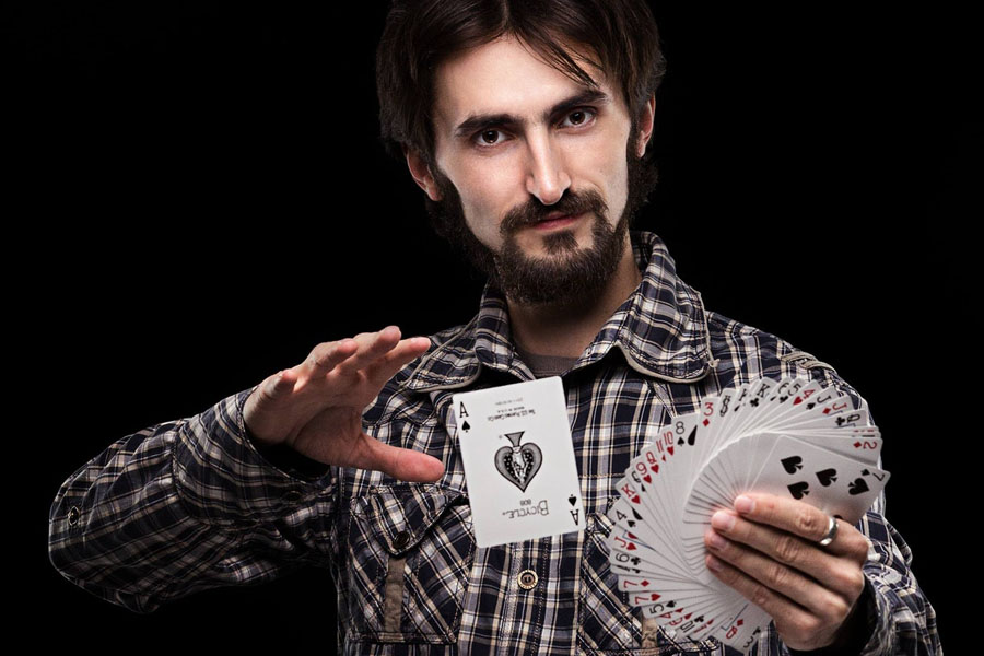 person performing floating card trick